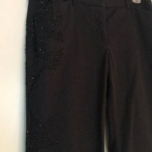 Black pants with beading on one leg